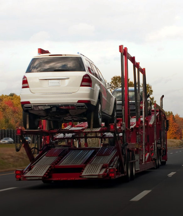 transporation truck on the long road carrying car