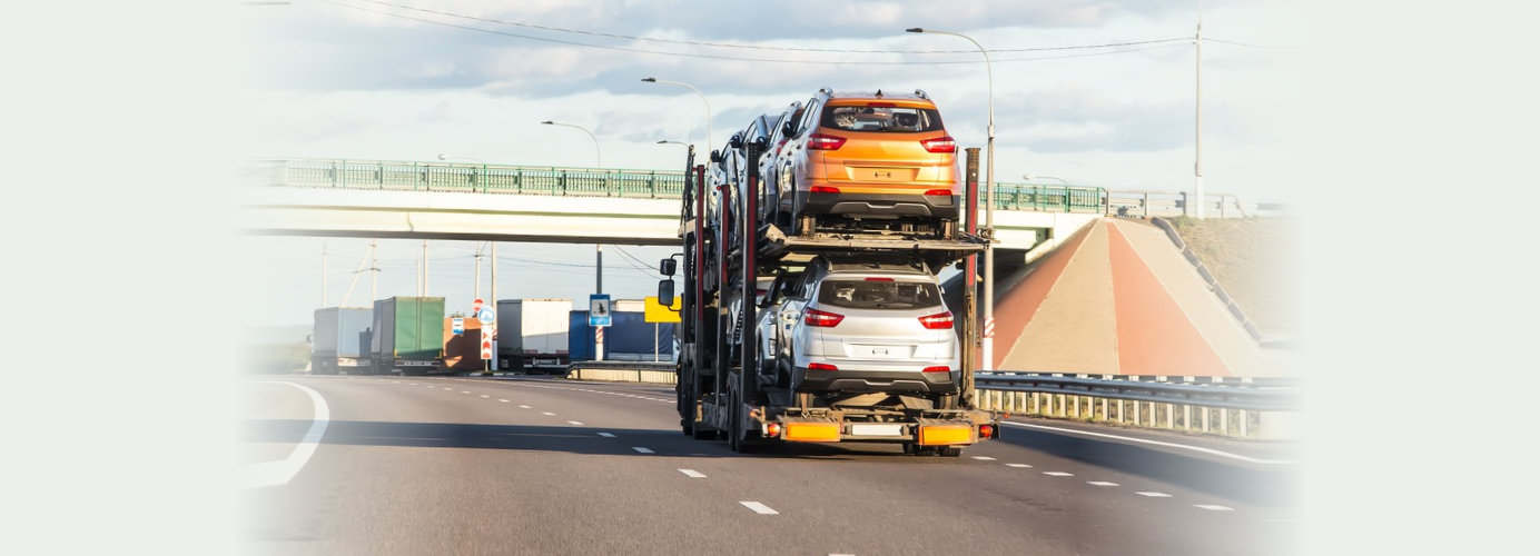 car transporter carries cars along the highway